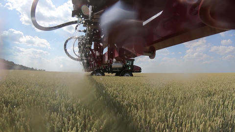 View from under the boom of self propelled sprayer during work Live Action