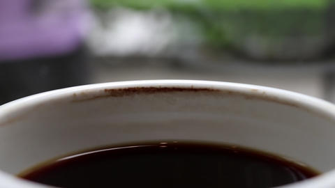 A cup of cooled down coffee over time. Waiting or relaxing Footage