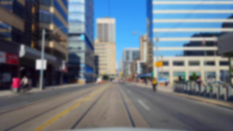 Driving Downtown City Street With Blur Effect. Driver Point of View POV of Urban Road With Tall Live Action