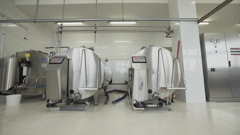 Milk factory equipment. Three pasteurization tanks placed at factory room Footage