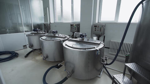 Dairy factory equipment. Tanks with control panel located in factory premises Footage