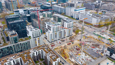 Aerial hyperlapse of construction cranes and building… Stock Video Footage
