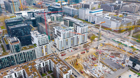 Aerial hyperlapse of construction cranes and building construction in the center Live Action