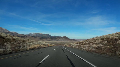 Driving Down Center Of Desert Road, colorful blue sky Footage
