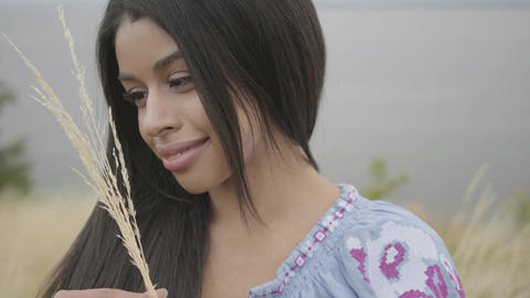 Portrait charming confident carefree African American girl wearing long summer Live Action