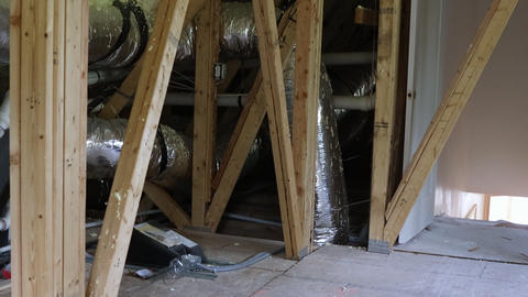 Installation of heating system pipes, valves close up on the roof of the house Live Action
