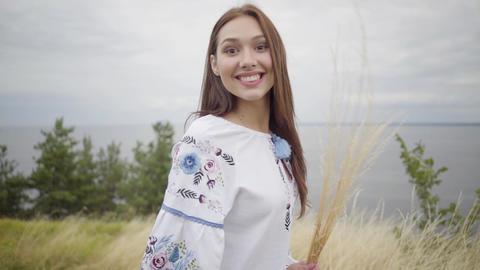 Portrait confident carefree caucasian girl wearing long summer fashion dress Live Action