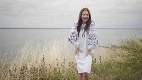 Fun charming carefree girl wearing long summer fashion dress looking confident Footage
