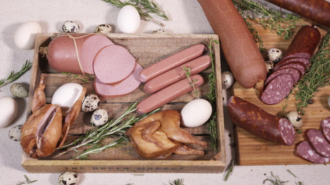 Natural meat food on cutting board upon table cloth Live Action