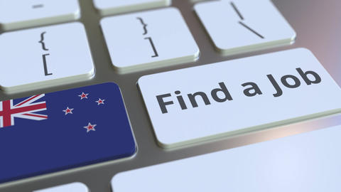 FIND A JOB text and flag of New Zealand on the buttons on the computer keyboard Live Action