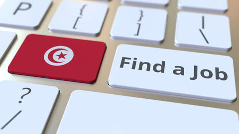 FIND A JOB text and flag of Tunisia on the buttons on the computer keyboard Live Action