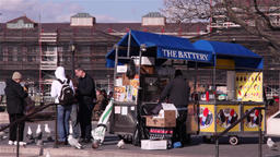 Street cart selling fast food at battery park in New York Footage
