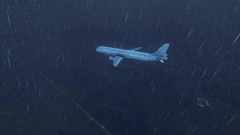 Passenger airplane in rainstorm night sky 4K Footage