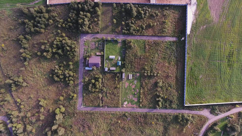 Flight over rural country houses, agricultural fields and roofs of modern farm Footage