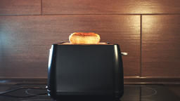Toast bread popping out from toaster Live Action
