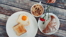 Light tasty breakfast with a cup of coffee Footage