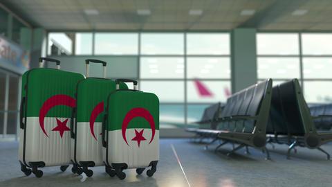 Travel suitcases with flag of Algeria. Algerian tourism conceptual 3D animation Live Action