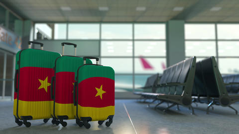 Travel suitcases with flag of Cameroon. Cameroonian tourism conceptual 3D Live Action