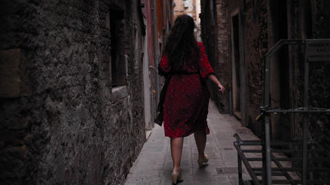 Carefree female tourist running in the of venice yard Live Action