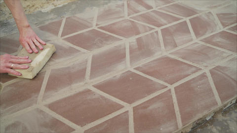 Figured laying of paving slabs on the square. Spread paving slabs Footage