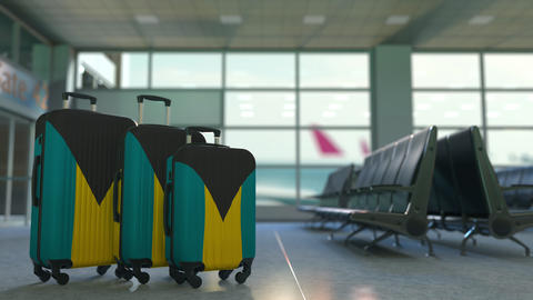 Travel suitcases with flag of Bahamas. Bahamian tourism conceptual 3D animation Live Action