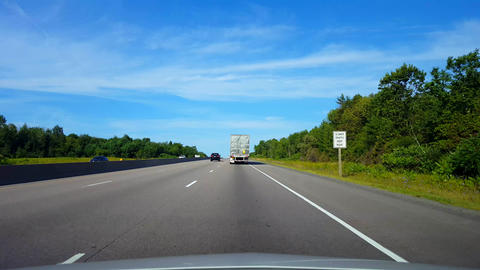 Drafting Large Truck on Highway During Summer Day. Driver Point of View POV Slipstreaming by Live Action