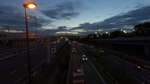 At sunset. Cars traveling on the highway ライブ動画