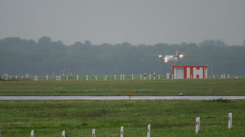 Turboprop plane approaching at rainy weather Live Action
