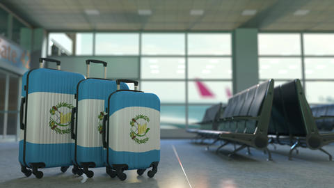 Travel suitcases with flag of Guatemala. Guatemalan tourism conceptual 3D Live Action