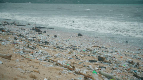 Plastic pollution beach. Heavy pile of garbage in asian countries. Ecology Footage
