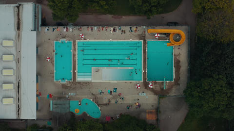 Aerial establishing shot of a public pool in a large city Live Action