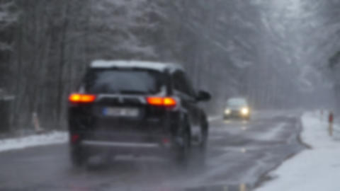 Winter road, snowing. Car on a snowy road. Bad winter road conditions Live Action