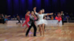 Balroom dancing. Anonymous defocused people dancing latin dances. Ballroom dancing Live Action