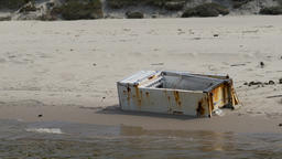 Scrap metal on the beach. Natural environment pollution Live Action