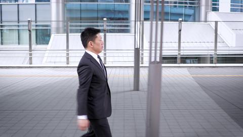 Japanese businessman walking in Tokyo Footage