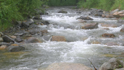 Stormy stream flows in rainy weather 001 Live Action