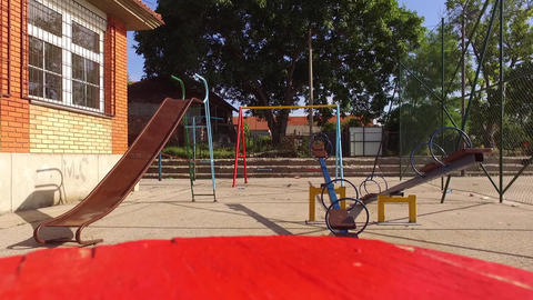 An empty park for kids in the summer GIF