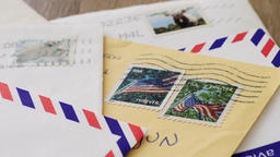 Old paper letters. Zooming at the usa stamps Live Action