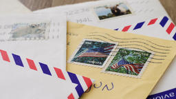 Traditional paper letters with us and canadian stamps. From blurred to focus Footage