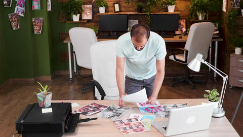Corporate designer checking for the last time his designs Live Action