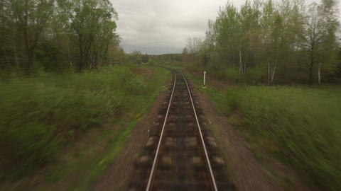 train POV railway track, curving rails, View from moving train window Landscape Live Action