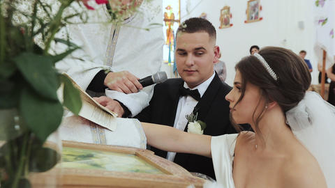 Couple are exchanging vows on their wedding day. Couple of newlyweds in church Live Action