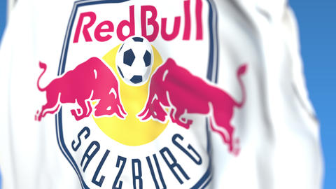 Flying flag with FC Red Bull Salzburg football club logo, close-up. Editorial Live Action