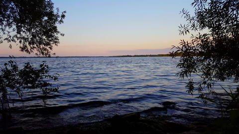 Beautiful View of Lake Water in Summer Morning. Tranquil Lakeside Scenery During Early Dawn With Live Action