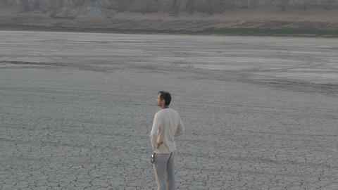 Time after sunset. A middle-aged man in simple clothes stands in the middle of a Live-Action