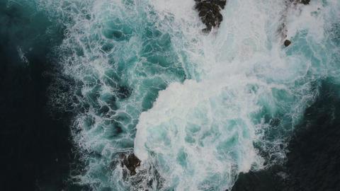 Aerial top view of ocean waves breaking on dark rocks, Canary Islands, Tenerife Live Action