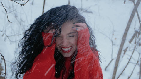 Girl smiling in snowy forest Live Action