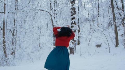 Girl dancing in snowy forest Live Action