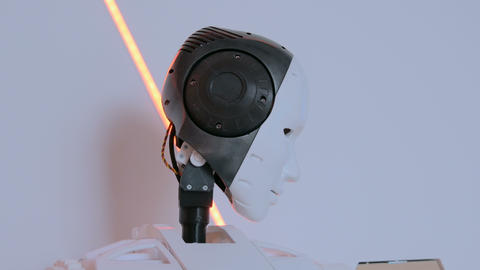 White humanoid robot moving head at technology exhibition Footage
