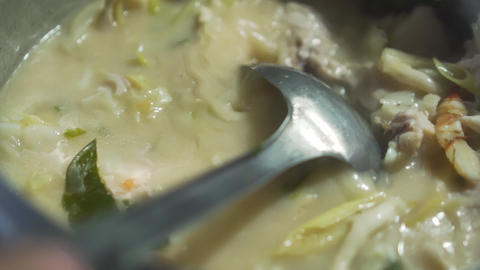 Thai Chicken Coconut Soup get boil and cooking by Thai chef. Slow Motion Live Action